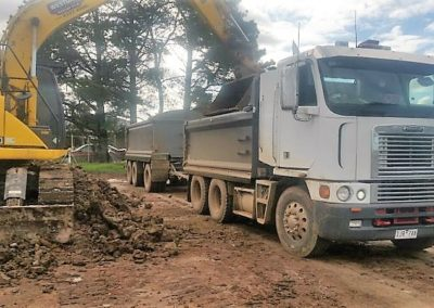 picture of excavator and truck
