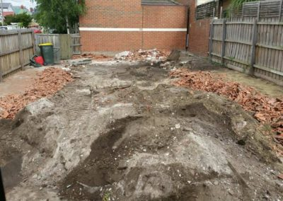 piles of dirt and broken brick at a job site before it was cleared
