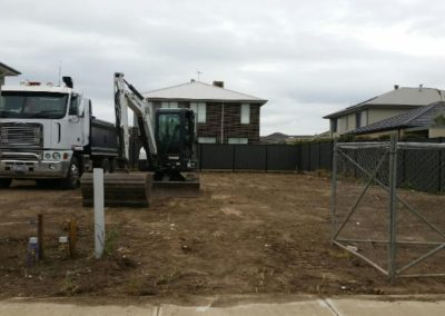 the transport trailer and excavator pictured on the job site