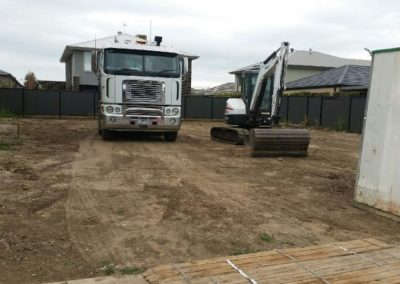 truck and digger at job site after it was cleared and leveled