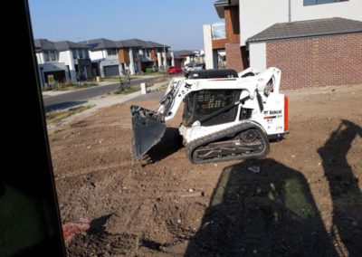 picture of our bobcat on a level and cleared site