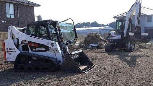 LNJ Excavation bobcat doing a site clean up