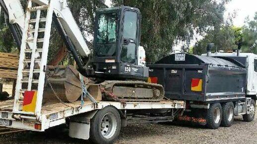 LNJ Excavation excavator on back of truck